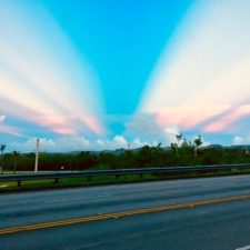 a sunset that looks like wings at the airforce base, how ironic
